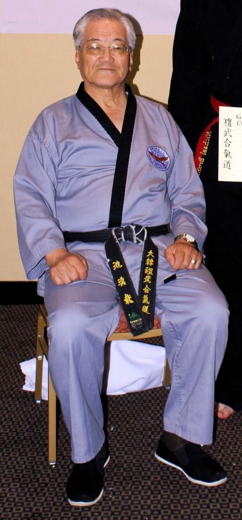 GM Ji, Han-jae of Sin Moo Hapkido in their offical grey uniform