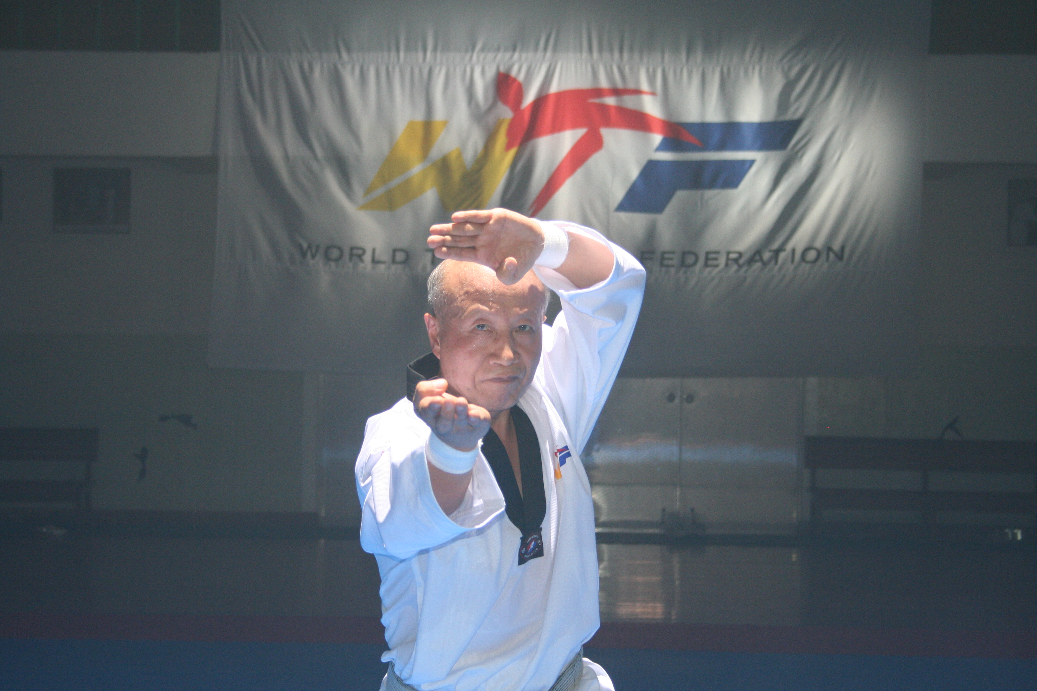 Master Lee Kyu-hyung, a taekwondo professor of Keimyung University, performs a poomsae demonstration for the WTF's promotional film at the Midong Elementary School in Seoul, Korea, on July 12, 2008.